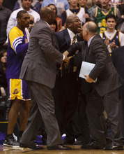 Trent Nelson  |  The Salt Lake Tribune Los Angeles coach Mike Brown is restrained after being ejected from the game in the fourth quarter as the Utah Jazz host the Los Angeles Lakers, NBA basketball Saturday, February 4, 2012 at EnergySolutions Arena in Salt Lake City, Utah.