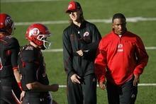 Chris Detrick  |  The Salt Lake Tribune Quarterback coach Brian Johnson and Utah Utes quarterback Jordan Wynn (3) before the game at Rice-Eccles Stadium Saturday October 29, 2011.