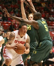 Paul Fraughton | The Salt Lake Tribune. Utah's Javon Dawson is blocked from the basket by Oregon defenders  E.J. Singler (25) and Olu Ashaolu. Oregon defeated the University of Utah  Utes 79 to 68 in the Huntsman center.  Thursday, February 2, 2012