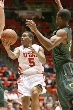 Paul Fraughton | The Salt Lake Tribune. Utah's Kareem Storey takes an underhand shot. Oregon defeated the University of Utah  Utes 79 to 68 in the Huntsman center.  Thursday, February 2, 2012