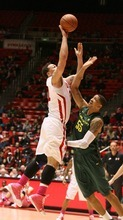 Paul Fraughton | The Salt Lake Tribune. Javon Dawson is fouled by Oregon's Tony Woods.Oregon defeated Utah 68 to 79 in The Huntsman Center.  Thursday, February 2, 2012