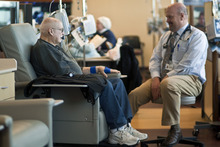 Chris Detrick  |  The Salt Lake Tribune Utah Cancer Specialists oncologist William Nibley treats Robbie Robertson for multiple myeloma at the Jon and Karen Huntsman Cancer Center at Intermountain Medical Center in Murray Wednesday February 1, 2012.