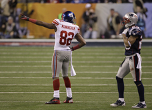 New York Giants wide receiver Mario Manningham (82) gestures after catching a pass during the second half of the NFL Super Bowl XLVI football game against the New England Patriots, Sunday, Feb. 5, 2012, in Indianapolis. (AP Photo/David Duprey)