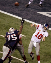 New York Giants quarterback Eli Manning passes to Mario Manningham against the New England Patriots during the second half of the NFL Super Bowl XLVI football game Sunday, Feb. 5, 2012, in Indianapolis. (AP Photo/Charlie Riedel)