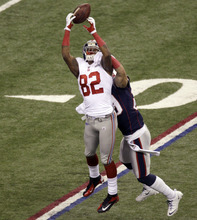New York Giants wide receiver Mario Manningham can't come up with a catch as New England Patriots defensive back Sterling Moore defends during the first half of the NFL Super Bowl XLVI football game Sunday, Feb. 5, 2012, in Indianapolis. (AP Photo/Charlie Riedel)