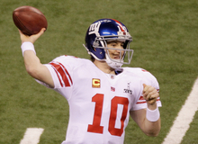 New York Giants quarterback Eli Manning throws against the New England Patriots  during the first half of the NFL Super Bowl XLVI football game Sunday, Feb. 5, 2012, in Indianapolis. (AP Photo/Charlie Riedel)