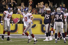New York Giants quarterback Eli Manning (10) celebrates after passing for a touchdown during the first half of the NFL Super Bowl XLVI football game against the New England Patriots, Sunday, Feb. 5, 2012, in Indianapolis. (AP Photo/David Duprey)