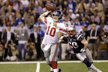 New York Giants quarterback Eli Manning (10) throws a pass in front of New England Patriots linebacker Rob Ninkovich (50) during the first half of the NFL Super Bowl XLVI football game Sunday, Feb. 5, 2012, in Indianapolis. (AP Photo/Eric Gay)