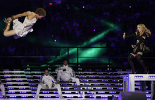 Madonna, right, performs during halftime of the NFL Super Bowl XLVI football game between the New York Giants and the New England Patriots, Sunday, Feb. 5, 2012, in Indianapolis. (AP Photo/Mark Humphrey)
