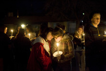 Kim Raff     The Salt Lake Tribune Shayanna Smith and Stormee Ryan become emotional at a vigil for the Powell family at Oquirrh Hills Elementary in Kearns on Sunday.