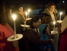 Kim Raff     The Salt Lake Tribune Cheyenne Miller, left, stands with her daughter Brooklyn Miller at a vigil Sunday she organized for the Powell family after the fire at Josh Powell's house that killed him and his sons, Charlie and Braden.