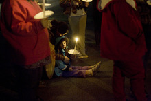 Kim Raff     The Salt Lake Tribune Cheyenne Miller and daughter Brooklyn Miller attend a vigil she organized for the Powell family after the fire at Josh Powell's house that killed him and his two sons, Charlie and Braden. The vigil was held at Oquirrh Hills Elementary in Kearns.