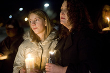 Kim Raff     The Salt Lake Tribune People attend the vigil in Kearns Sunday for the Powell family after the fire that killed Josh Powell and his two sons, Charlie and Braden, in Washington state.