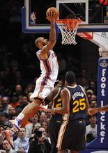 New York Knicks' Tyson Chandler (6) dunks over Utah Jazz's Paul Millsap and Al Jefferson (25) during the first half of an NBA basketball game Monday, Feb. 6, 2012, in New York. (AP Photo/Kathy Kmonicek)