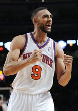 New York Knicks' Jared Jeffries (9) cheers toward the crowd as the Knicks lead the Utah Jazz in the second half of an NBA basketball game Monday, Feb. 6, 2012, in New York. The Knicks won 99-88. (AP Photo/Kathy Kmonicek)