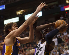 Trent Nelson  |  The Salt Lake Tribune Utah Jazz guard/forward C.J. Miles (34) grabs a rebound, Los Angeles Lakers' Pau Gasol (16) at left as the Utah Jazz host the Los Angeles Lakers, NBA basketball Saturday, February 4, 2012 at EnergySolutions Arena in Salt Lake City, Utah.