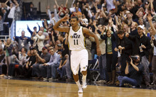 Trent Nelson  |  The Salt Lake Tribune Utah Jazz guard Earl Watson (11) celebrates a three-point shot that put the Jazz up 94-83 in the fourth quarter. Utah Jazz host the Los Angeles Lakers, NBA basketball Saturday, February 4, 2012 at EnergySolutions Arena in Salt Lake City, Utah.