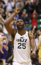 Trent Nelson  |  The Salt Lake Tribune Utah Jazz center/forward Al Jefferson (25) points to the roof as the Jazz lead in the fourth quarter as the Utah Jazz host the Los Angeles Lakers, NBA basketball Saturday, February 4, 2012 at EnergySolutions Arena in Salt Lake City, Utah.