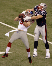 New York Giants linebacker Chase Blackburn (93) intercepts a pass from New England Patriots quarterback Tom Brady as Patriots tight end Rob Gronkowski (87) looks on NFL Super Bowl XLVI football game, Sunday, Feb. 5, 2012, in Indianapolis. (AP Photo/Charlie Riedel)