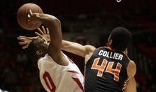 Kim Raff |The Salt Lake Tribune University of Utah player Chris Hines takes a shot as Oregon State player Devon Collier defends at the Huntsman Center in Salt Lake City, Utah on February 4, 2012.