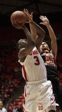 Kim Raff |The Salt Lake Tribune University of Utah player Anthony Odunsi takes a shot as Oregon State player Roberton Nelson defends during the second half at the Huntsman Center in Salt Lake City, Utah on February 4, 2012. Utah went on the lose the game 58-76.