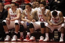 Kim Raff |The Salt Lake Tribune (from left) University of Utah players Jason Washburn, Javon Dawson, Cedric Martin, and Chris Hines sit on the bench in the final minutes as they trial by 18 points against Oregon State at the Huntsman Center in Salt Lake City, Utah on February 4, 2012. Utah went on the lose the game 58-76.