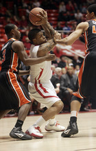Utah's Kareem Storey, center, is surrounded by Oregon State players Ahmad Stark,left, and Devon Collier during the first half of an NCAA college basketball game at the Huntsman Center in Salt Lake City, Utah on  Saturday Feb. 4, 2012. (AP Photo/The Salt Lake Tribune,Kim Raff)