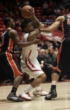 Kim Raff |The Salt Lake Tribune University of Utah player (middle) Kareem Storey is surrounded by Oregon State players (left) Ahmad Stark and Devon Collier during the first half at the Huntsman Center in Salt Lake City, Utah on February 4, 2012.