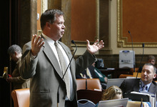 Scott Sommerdorf  |  The Salt Lake Tribune              Rep. Eric Hutchings, R-Kearns, speaks in favor of HB210 n the Utah House Monday. The bill to lock up oil and gas revenues in a special fund was narrowly defeated.