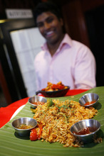 Francisco Kjolseth  |  The Salt Lake Tribune Jett Selvaratnam, chef and owner of the Banana Leaf at 409 N. University Ave. in Provo, along with his wife Ariana, serves up an order of Malay Style Chicken Nasi Goreng, a fried rice with tender chicken, fried with vegetables, basmati rice and chef's special secret sauce.