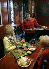 Francisco Kjolseth  |  The Salt Lake Tribune Ariana Selvaratnam, co-owner of The Banana Leaf at 409 N. University Ave. in Provo, explains some of the dishes ordered by first-time customers Patti Heal, left, and her mother-in-law Louise Heal on Thursday, Feb. 2, 2012.