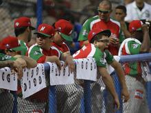 A Mexico player yawns during his team's Caribbean Series baseball game against Venezuela at Quisqueya stadium in Santo Domingo, Dominican Republic, Tuesday Feb. 7, 2012. Venezuela went on to defeat Mexico 6-2. (AP Photo/Fernando Llano)