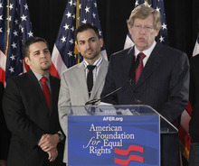 Prop 8 paintiffs: Jeff Zarrillo, left, and Paul Katami, middle, listen to Ted Olson, American Foundation for Equal Rights Lead Co-counsel's comment on the announcement of California's same-sex marriage ban to be unconstitutional, during a American Foundation for Equal Rights conference in Los Angeles on Tuesday, Feb. 7, 2012. A federal appeals court has declared California's same-sex marriage ban to be unconstitutional, paving the way California's same-sex marriage ban to be a likely U.S. Supreme Court showdown on the voter-approved law. (AP Photo/Damian Dovarganes)