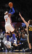 New York Knicks' Carmelo Anthony (7) shoots over Utah Jazz's Gordon Hayward (20) during the first half of an NBA basketball game Monday, Feb. 6, 2012, in New York. (AP Photo/Kathy Kmonicek)