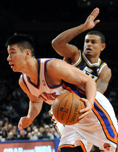 New York Knicks' Jeremy Lin (17) drives the ball past Utah Jazz's Earl Watson (11) during the second half an NBA basketball game Monday, Feb. 6, 2012, in New York. Lin scored 28 points during the Knicks' 99-88 win. (AP Photo/Kathy Kmonicek)