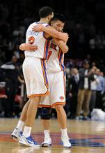 New York Knicks' Landry Fields (2) hugs Jeremy Lin after the Knicks beat the Utah Jazz 99-88 in an NBA basketball game Monday, Feb. 6, 2012, in New York. (AP Photo/Kathy Kmonicek)