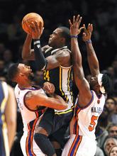New York Knicks' Jared Jeffries, left, and Bill Walker (5) guard Utah Jazz's Paul Millsap (24) during the second half of an NBA basketball game Monday, Feb. 6, 2012, in New York. The Knicks won 99-88. (AP Photo/Kathy Kmonicek)