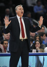 New York Knicks coach Mike D'Antoni calls to his team during the first half of an NBA basketball game against the Utah Jazz on Monday, Feb. 6, 2012, in New York. The Knicks won 99-88. (AP Photo/Kathy Kmonicek)