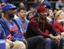 New York Giants' Aaron Ross, right, watches the NBA basketball game between the Utah Jazz and the New York Knicks on Monday, Feb. 6, 2012, in New York, the day after the Giants defeated the New England Patriots in the NFL football Super Bowl. (AP Photo/Kathy Kmonicek)