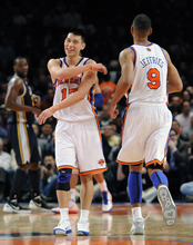 New York Knicks' Jeremy Lin (17) smiles next to Jared Jeffries (9) during the second half of an NBA basketball game against the Utah Jazz on Monday, Feb. 6, 2012, in New York. Lin scored 28 points in his first career start as the Knicks won 99-88. (AP Photo/Kathy Kmonicek)