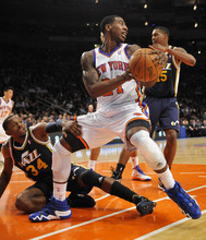 New York Knicks' Iman Shumpert (21) recovers the ball from Utah Jazz's C.J. Miles (34) during the first half of an NBA basketball game Monday, Feb. 6, 2012, in New York. The Knicks won 99-88. (AP Photo/Kathy Kmonicek)