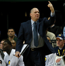 Chet Strange | Special to The Tribune Jim Boylen reacts after a foul is called on the Indiana Pacers during their game against the New Jersey Nets on Tuesday, Jan. 31.  The former University of Utah head coach, known for his fiery personality, has been relegated to a more subordinate role as one of two Pacers assistant coaches.