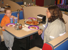 Judy Cox has pizza with her grandson, Braden Powell, in Puyallup, Wash., in this family photo from last October.