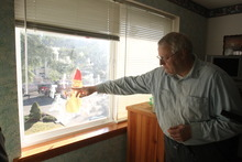 Rick Egan  | The Salt Lake Tribune   Chuck Cox, father of Susan Powell, points to a snowman and snow flakes that his grandson Charlie Powell made, in the window of his room in Puyallup, Wash., Monday, Feb. 6, 2012.