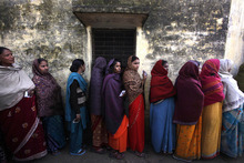Indian voters stand in a queue to cast their votes outside a polling station, in Ayodhya, India, Wednesday, Feb. 8, 2012. Residents in India's largest state began voting Wednesday in a monthlong local election with repercussions for the whole nation. The state of Uttar Pradesh is so large, with 200 million people, that voting is spread over seven phases and will last until March 3. Results will be declared March 6. (AP Photo/ Manish Swarup)