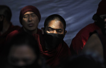 Tibetan exiled monks participate in a rally to show solidarity with Tibetans who have either set themselves on fire or were allegedly killed by Chinese police, during a protest march in New Delhi, India, Wednesday, Feb. 8, 2012. China on Tuesday vowed to crack down on unrest in Tibetan areas and accused overseas activist groups and the Dalai Lama of fomenting the recent violence. More than a dozen monks and nuns have set themselves on fire in ethnic Tibetan areas of Sichuan over the last year. Most have chanted for Tibetan freedom and the return of the Dalai Lama, who fled to India amid an abortive uprising against Chinese rule in 1959.  (AP Photo/Saurabh Das)