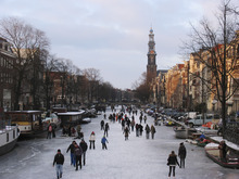 People skate on the frozen Prinsengracht canal in Amsterdam, Netherlands, Wednesday Feb. 8, 2012. In Amsterdam, several of the city's famous canals have frozen over, giving residents a rare opportunity to skate lined by waterfront houses. (AP Photo/Margriet Faber)