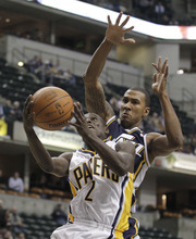 Indiana Pacers' Darren Collison puts up a shot against Utah Jazz's Raja Bell during the first half of an NBA basketball game Tuesday, Feb. 7, 2012, in Indianapolis. (AP Photo/Darron Cummings)