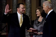 Djamila Grossman  |  Tribune file photo Sen. Mike Lee, R-Utah, was sworn in last year by Vice President Joe Biden, as his wife, Sharon, holds the Bible. Getting the federal debt under control has been his No. 1 issue.