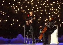Rick Egan | The Salt Lake Tribune file photo Sting and cellist Yo Yo Ma perform during the Opening Ceremony at Rice-Eccles Stadium.